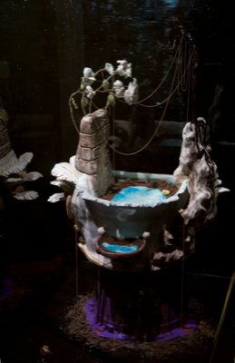 Irini Miga, Siesta Or An Attempt To Preserve The Remnants Of Vital Reflections , detail view, 2011, glazed clay, soil, water, chains, jewels, feathers, ribbons, plastic, colored rubber 56 x 48 x 40 / pedestal: 75 x 50 x 45 - plexiglas: 70 x 50 x 45, Courtesy the artist and The Breeder, Athens