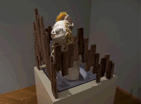 Irini Miga, When You Think I am Not There, Please Knock Harder (Act IV - It is Always Bright On The Other Side), 2011, glazed clay, ribbons, jewels, feathers/ girl: 55 x 32 x 37 cm - fence: 48 x 49 x 52 / pedestals: 100 x 38 x 37 - 100 x 51 x 57, Courtesy the artist and The Breeder, Athens