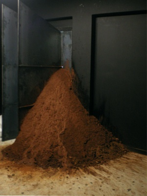 Eleni Panouklia, Sofia Kamayianni. Decision. 2011. Site specific installation with sound. Black metal sheets, soil from excavations, magnet, spool, metal beam, graphite, sound. Dimensions in the space of ReMap 3: Black room:240x300x120 cm, soil: 140x140 x120 cm, pendulum: 42x42x210 cm. Courtesy Qbox Gallery.