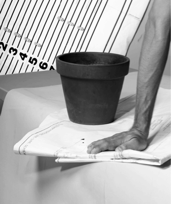 Michele Abeles, Pot, Paper, Hand, Lines, Numbers, Table, 2010, archival pigment print, 25 1/4 x 31 in/ 64.1 x 78.1 cm